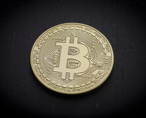Coin with Bitcoin logo