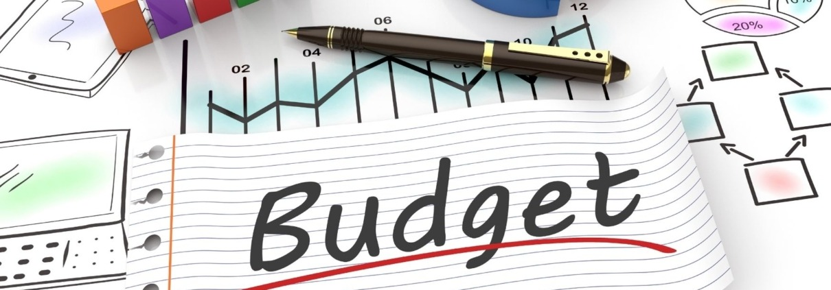 Budget written on paper laying on drawings of graphs
