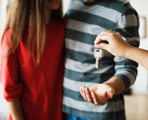 Young couple receiving house keys