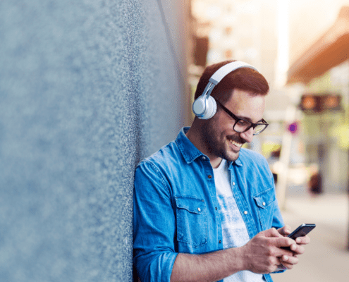Young man listening with headphones on