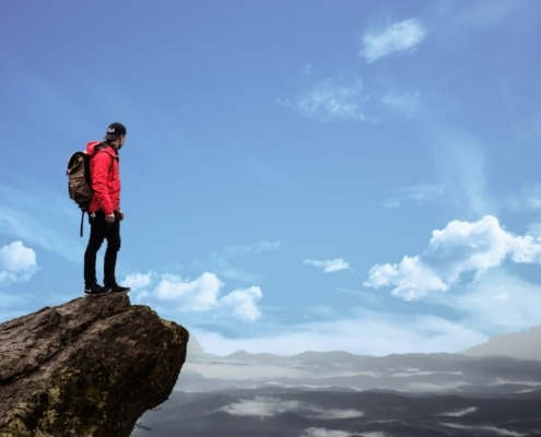 Young man standing on rock outcropping